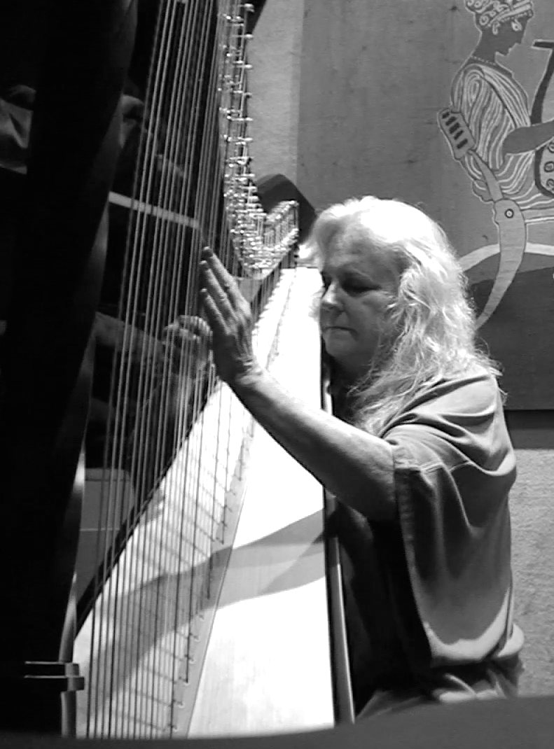 Susan Allen playing harp